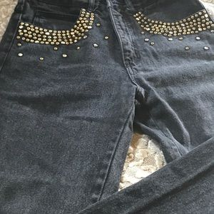 Black jeans with studded pockets
